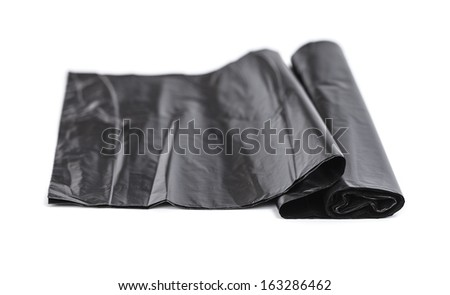 black plastic trash bags isolated on white background - stock photo