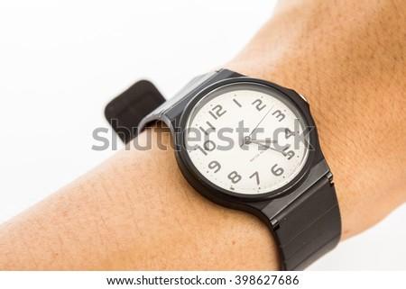 black plastic wrist watch with hand. - stock photo
