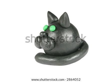 Black plasticine cat isolated on white