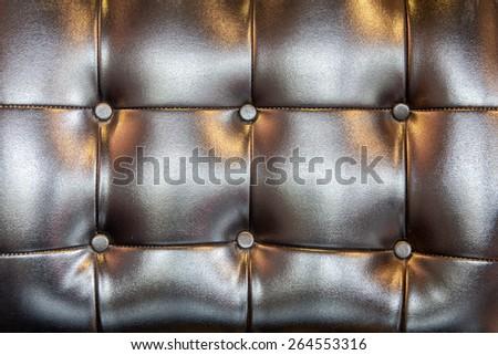 Black Polish leather texture from sofa - stock photo
