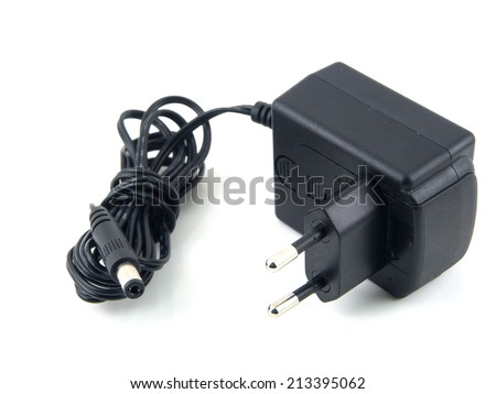 Black power ac to dc adaptor in white background - stock photo