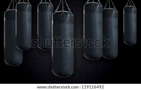 black Punching bag for boxing or kick boxing sport. - stock photo
