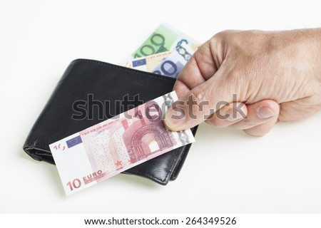 black purse and male hand holding a miniature play money euro banknote on a white background. Financial concept for capital loss and inflation - stock photo