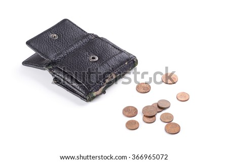 Black purse with old coins. - stock photo