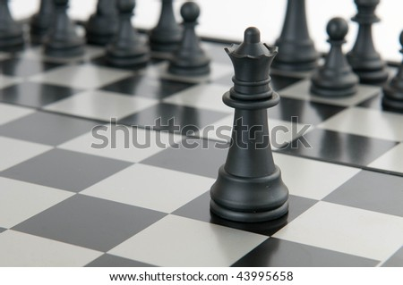 Black queen on a board - stock photo