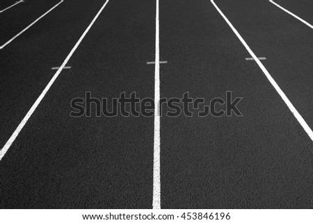 Black race track with numbers.