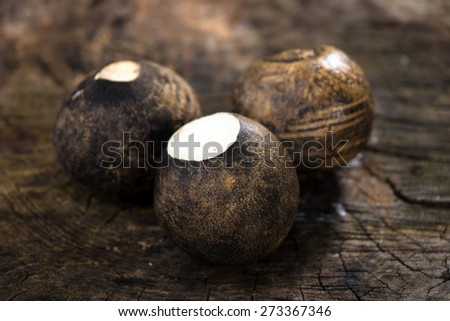 Black radish on wooden background   - stock photo