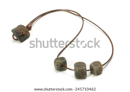 Black raw amber necklace isolated on the white background - stock photo