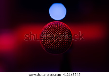 Black red background microphone - stock photo