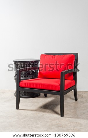Black red Chair and side table in a bright setting - stock photo