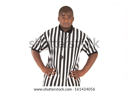 Black referee calling offsides or blocking foul - stock photo