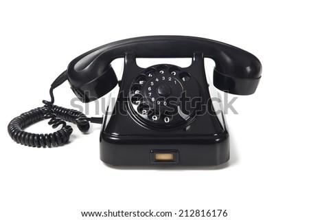 Black retro phone on a white background - stock photo