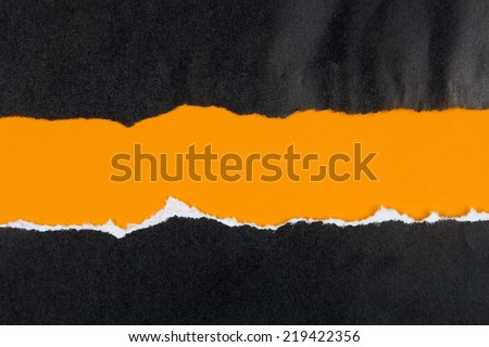 black ripped paper, orange space for copy - stock photo