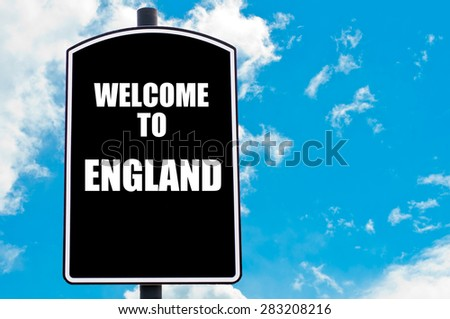 Black road sign with greeting message WELCOME TO ENGLAND isolated over clear blue sky background with available copy space. Travel destination concept  image