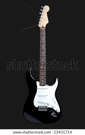 Black rock guitar isolated on dark gray - stock photo
