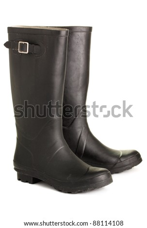 Black, rough rubber boots, isolated on a white background - stock photo