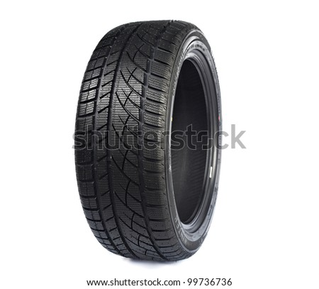 Black rubber car wheel against white background with protector - stock photo