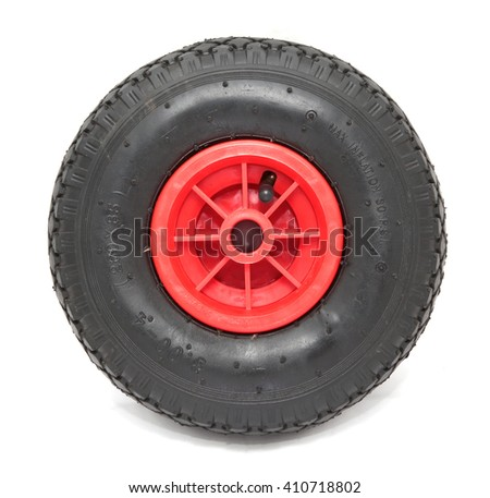 Black rubber inflatable wheel with red plastic center for outboard engine pushcart isolated on white front view - stock photo