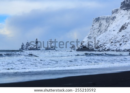 Black sand and white snow in Vik, Iceland - stock photo