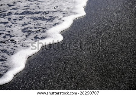 Black sand beach in Hawaii. - stock photo