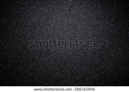 black sandpaper texture background. - stock photo
