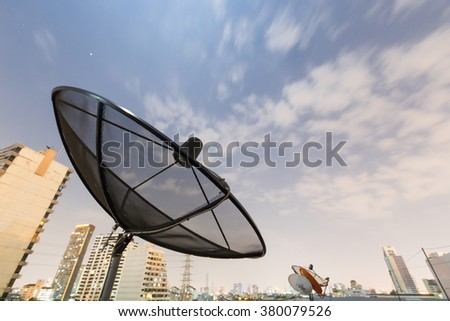 Black Satellite dish and moving sky