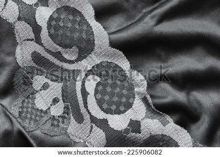 Black satin and lace closeup as a background - stock photo