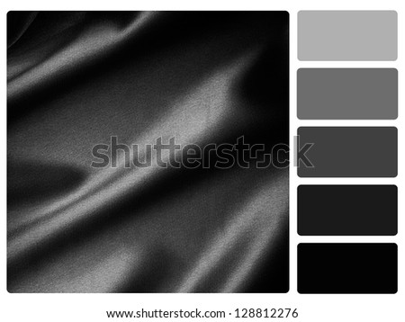 Black satin color palette with complimentary swatches. - stock photo