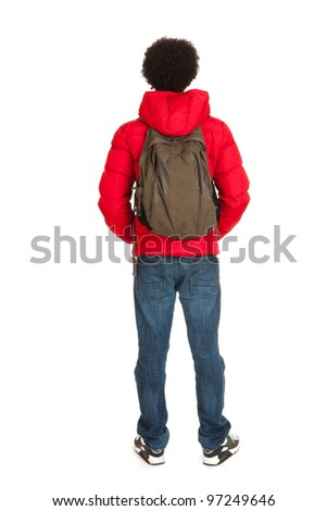 Black school boy in red coat wit backpack on back side - stock photo