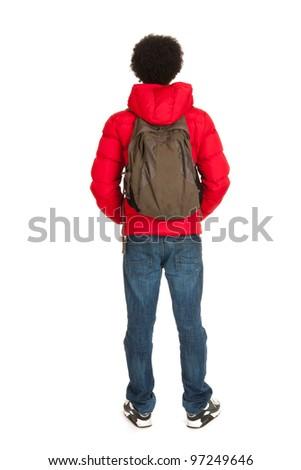 Black school boy in red coat wit backpack on back side - stock photo