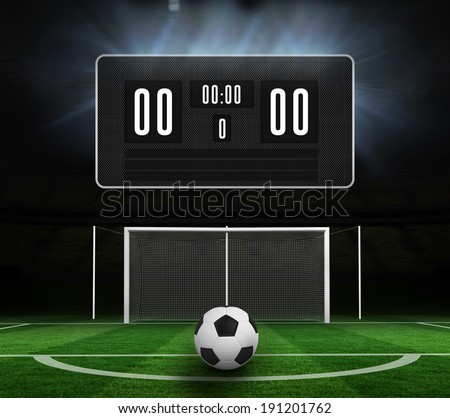 Black scoreboard with no score and football against football pitch under spotlights - stock photo
