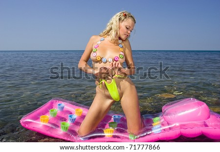 Black Sea. A beautiful young blonde on an inflatable mattress.