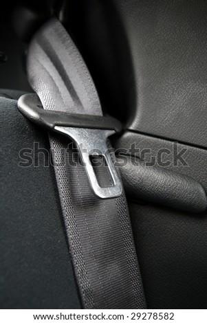 Black Seatbelt in a small car - stock photo