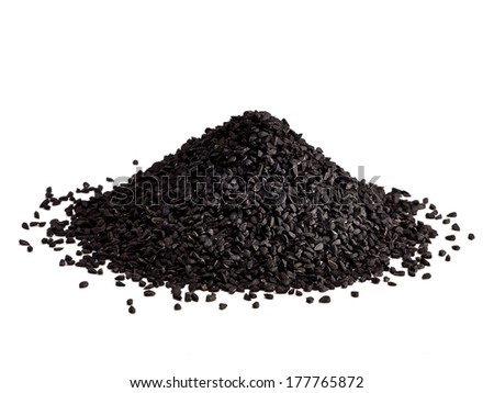 Black seed, Nigella  sativa or Kalinji seeds pile on white background - stock photo