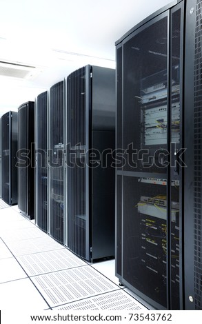 Black servers and hardwares in an internet data center - stock photo