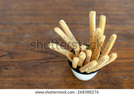 black sesame bread sticks  - stock photo