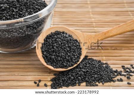 Black sesame on wooden spoon  - stock photo