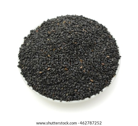 black sesame seeds in bowl isolated on white background