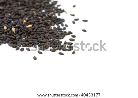 Black sesame seeds isolated on white background with clipping path - stock photo