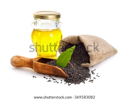 Black sesame seeds with oil. Isolated on white background. - stock photo