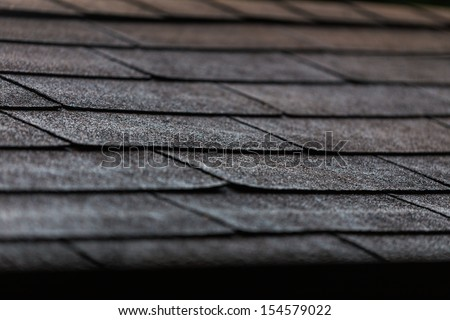 black shingles on a roof in close up - stock photo