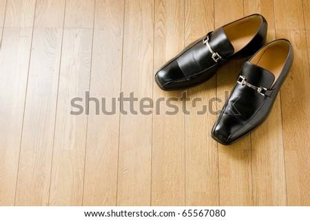 black shiny man's shoe - stock photo