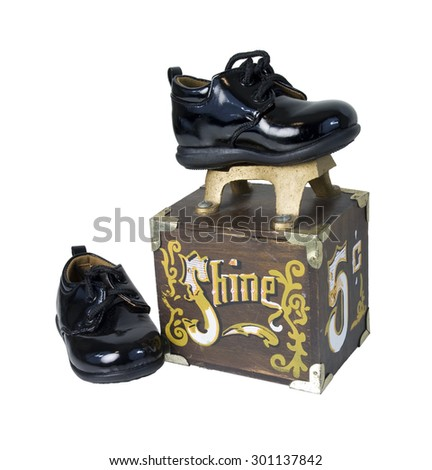 Black shiny shoes on a Vintage shoe shine box used to manually polish formal shoes - path included - stock photo