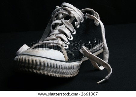 Black shoe with laces - stock photo