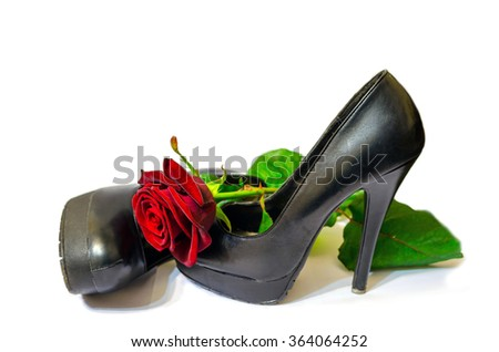 Black shoes and red rose on white background  - stock photo