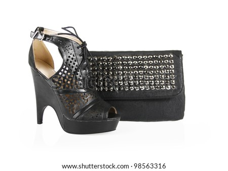 black shoes and spiked bag isolated on white - stock photo