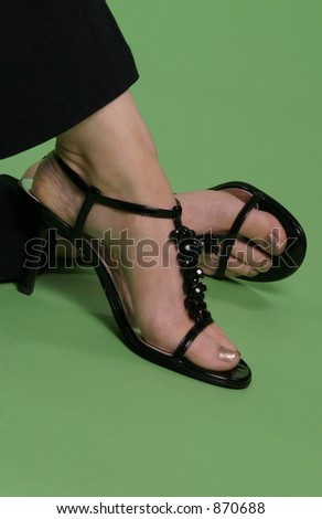 black shoes on green background - stock photo