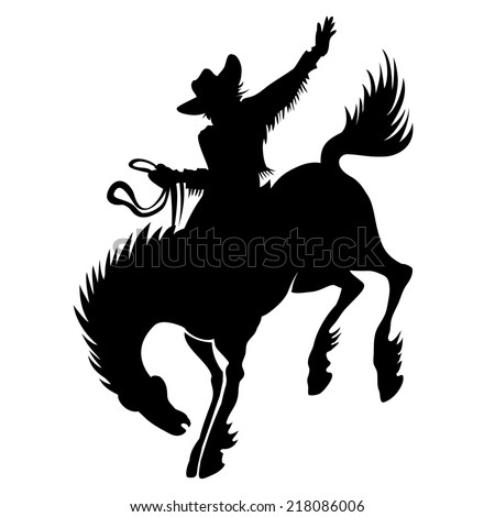 Black silhouette of cowboy at rodeo riding wild stallion bucking bronco showing off his horsemanship and skill - stock photo
