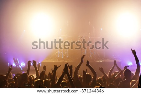 Black silhouette of people on rock concert - stock photo