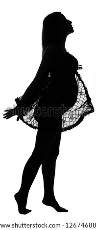 Black silhouette of pregnant woman in lacy tippet on white background - stock photo